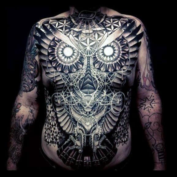 Guy's Owl Eyes Tattoo On Stomach And Chest