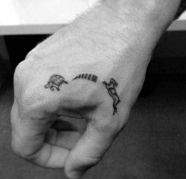 Guys Quarter Sized Turtle And Rabbit Speed Hand Tattoo Design Ideas