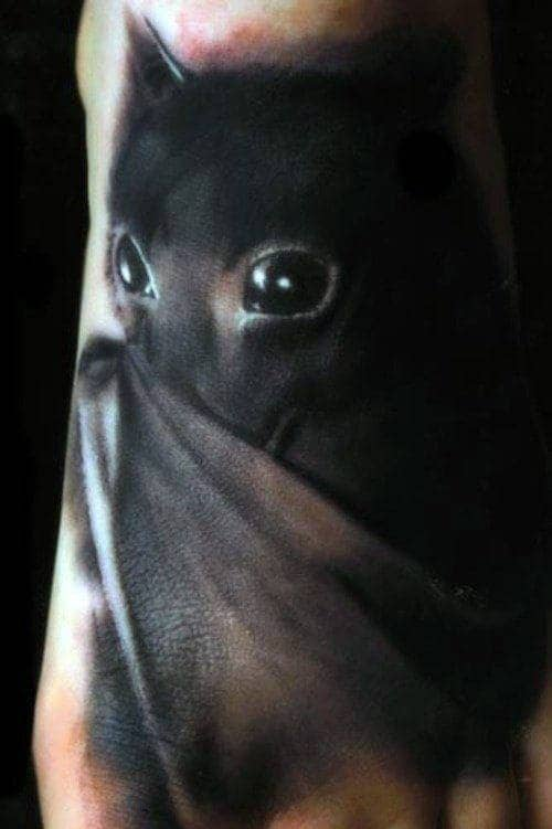 Guys Realistic Black With Bat Wings Tattoo On Foot