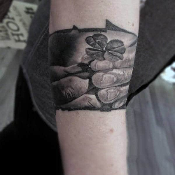 Guys Realistic Tattoos Of Four Leaf Clovers On Forearm