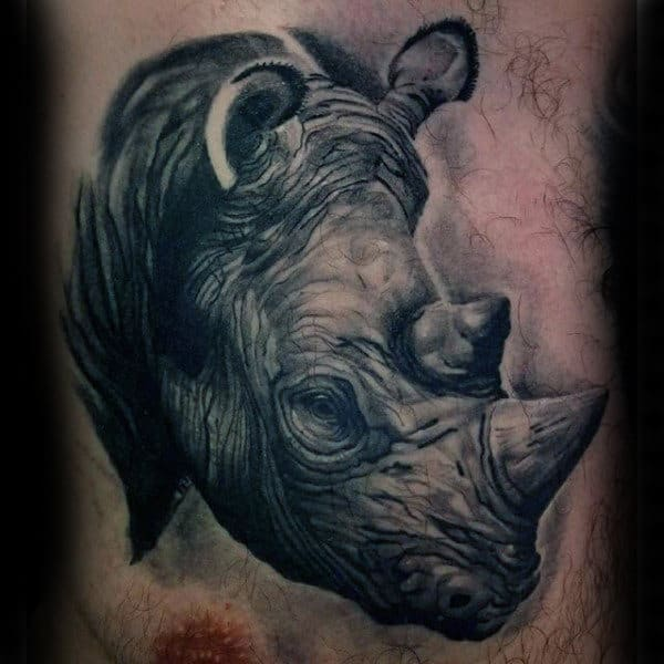 Guys Rhino Chest Tattoo Designs