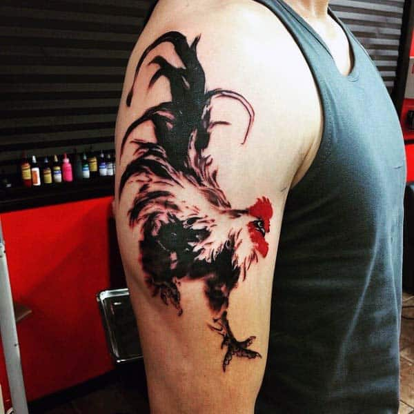 Guys Rooster Tattoo With Red Ink On Upperarm