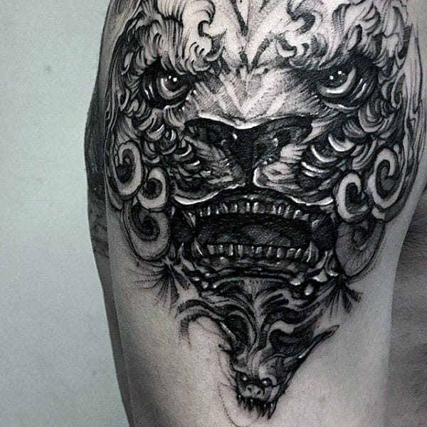 Guys Shaded Black And Grey Upper Arm Foo Dog Tattoo