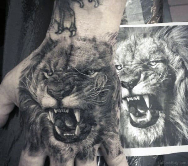 Guys Shaded Realistic 3d Lion Hand Tattoo