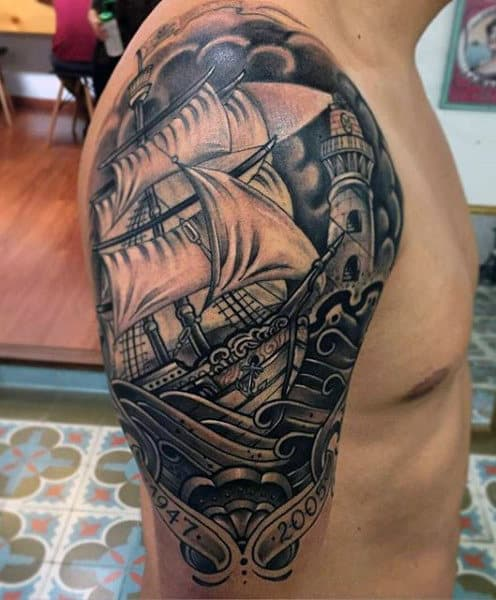 Guy's Ship In Storm Tattoo On Arm And Shoulder
