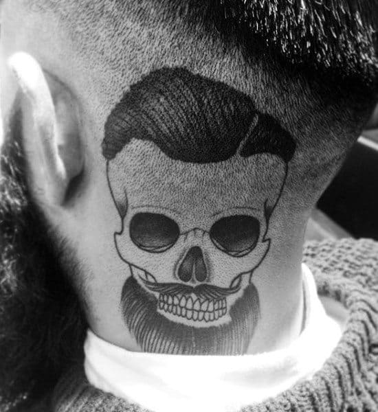 Guys Skull Barber Tattoo With Thick Hair And Beard