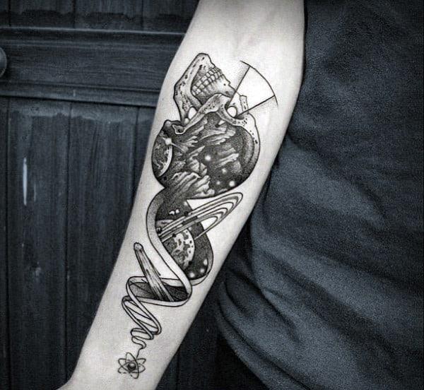 Guys Skull Space Black Ink Tattoos On Inner Forearm And Wrist