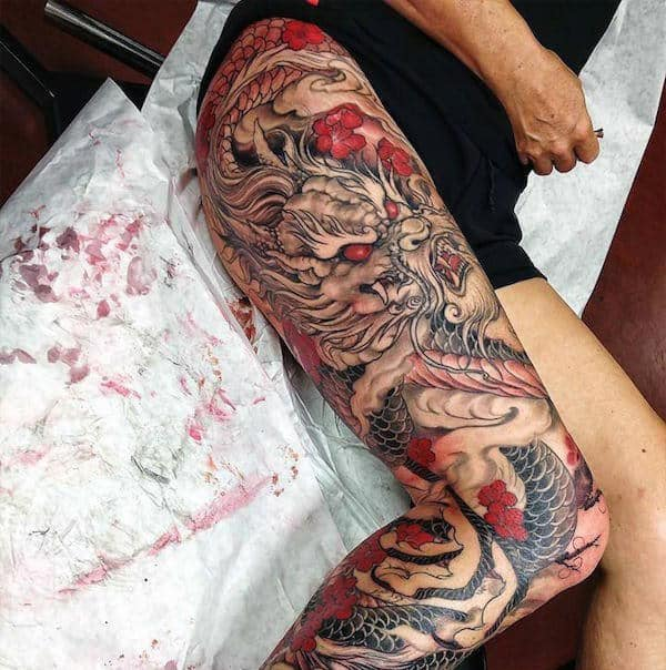 Guys Sleeve Thigh Tattoo Of Japanese Red Dragoon