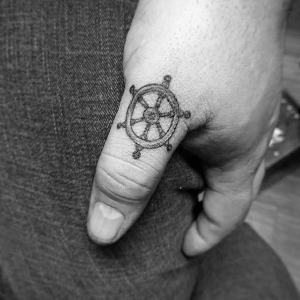 Guys Small Manly Ship Wheel Thumb Tattoo Designs