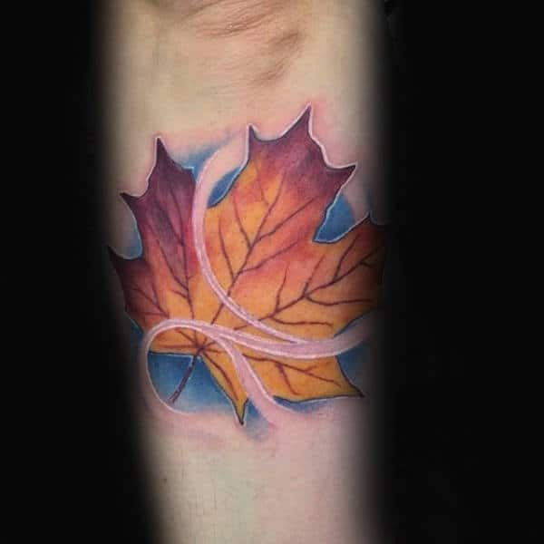 Guys Small Maple Leaf Blowing In The Wind Outer Forearm Tattoo