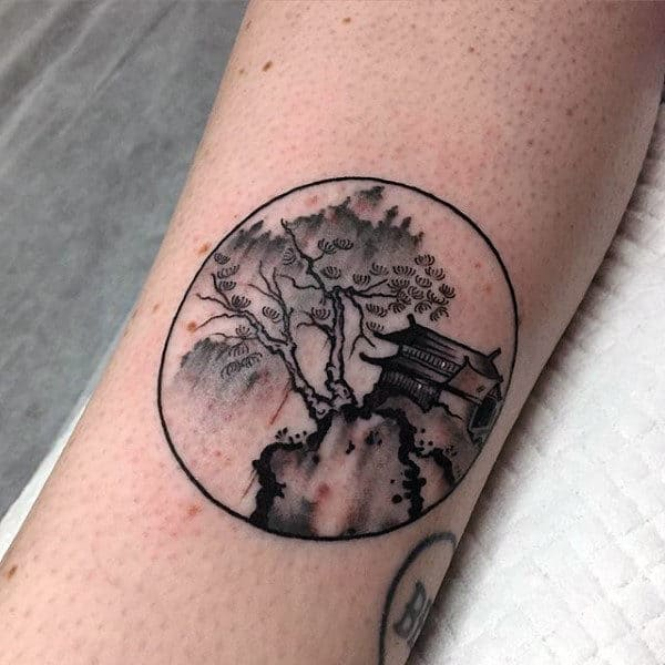 Guys Small Simple Circle Chinese Nature Tattoo On Forearm