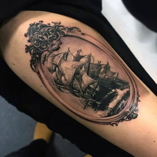 Guy's Small Tattoos Of Pirate Ships On Thigh