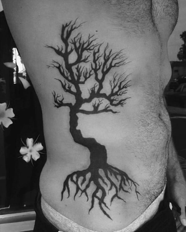 Guys Solid Black Ink Tree Roots Rib Cage Tattoo