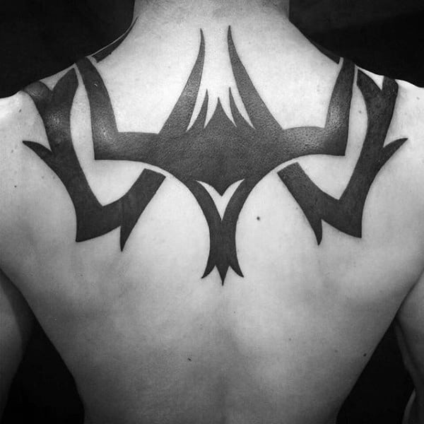 Guys Solid Black Ink Tribal Upper Back Tattoos