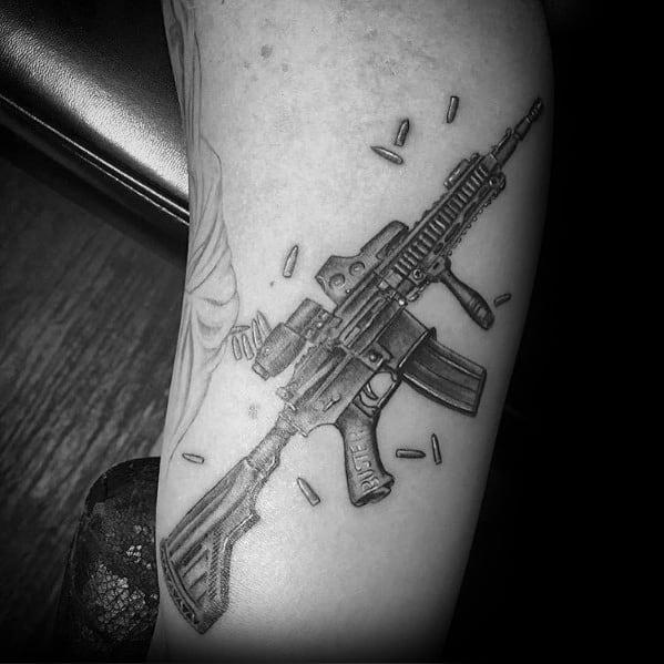 Guys Tattoo Ar 15 Rifle Design On Arm