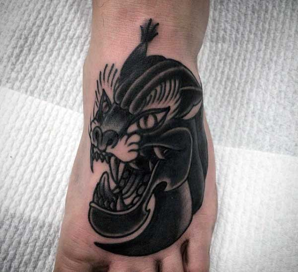 Guys Tattoo Of Black Panther On Foot