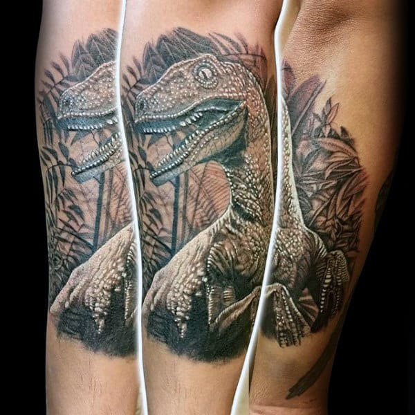 Guys Tattoo On Outer Forearm Of Velociraptor