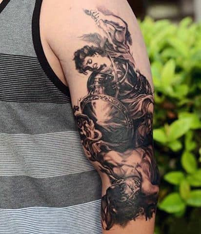 Guy's Tattoos Of St Micheal The Archangel In Black Ink