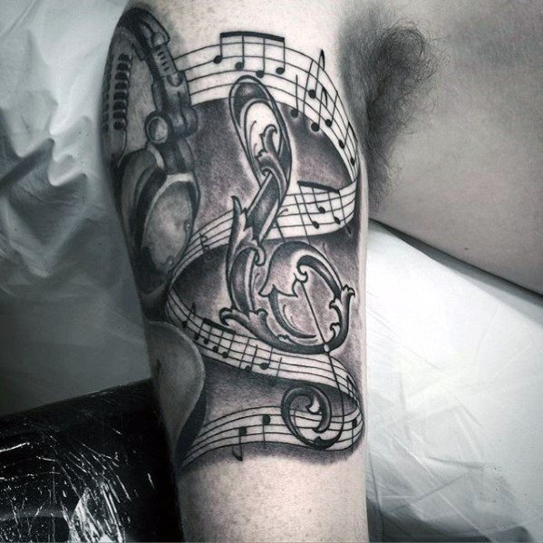 Guys Tattoos With Headphones Music Notes Design On Arm
