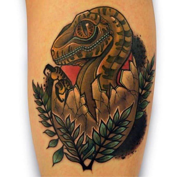 Guys Tattoos With Jurassic Park Dinosaur Egg Design On Arm