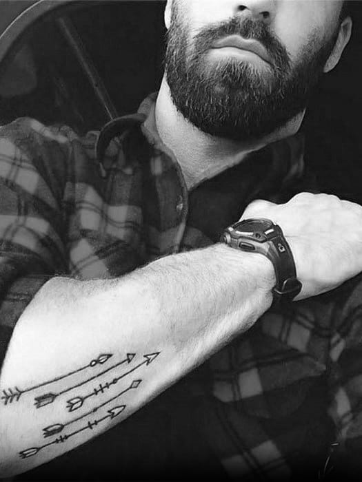 Guys Tattoos With Small Arrow Design Outer Forearm