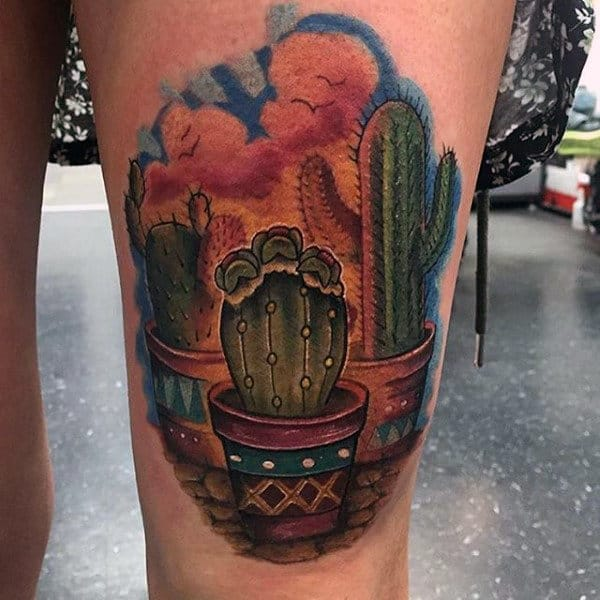 Guys Thigh Tattoo Of Cactus With Colorful Clouds