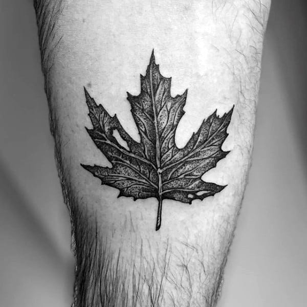 Guys Thigh Tattoo Of Maple Leaf