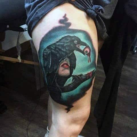 Guys Thighs Black Raven Holding Eye Ball Tattoo