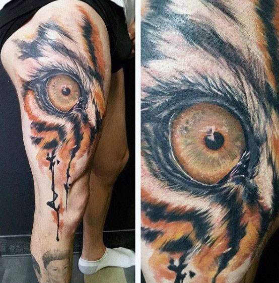 Guys Tiger Eyes Tattoos On Leg And Thigh