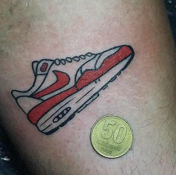 Guys Tiny Simple Nike Sneaker Tattoo On Arm