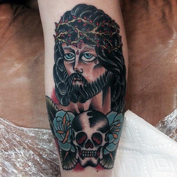 Guys Traditional Jesus Leg Tattoo With Skull Design