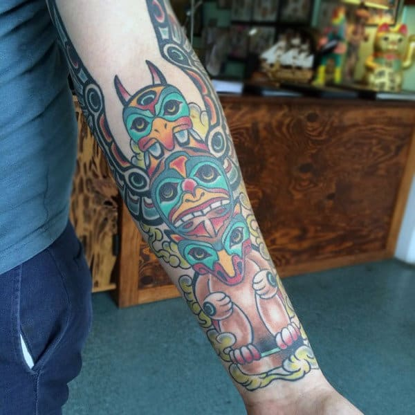 Guys Traditional Totem Pole Forearm Half Sleeve Tattoo