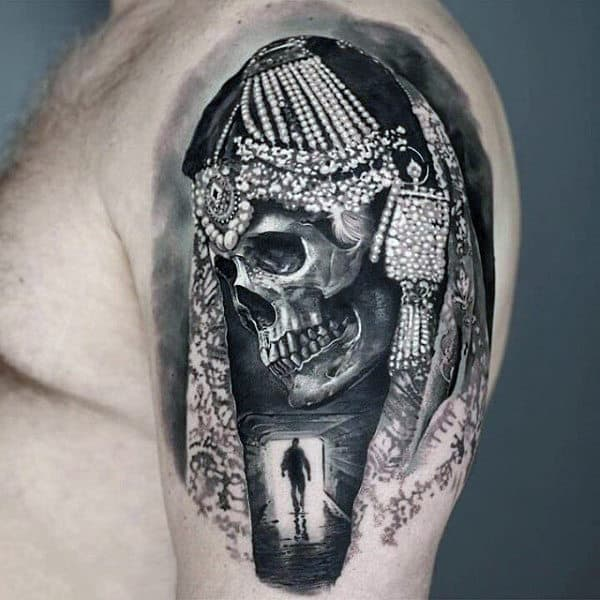 Guys Upper Arms Bejewelled Skull Tattoo