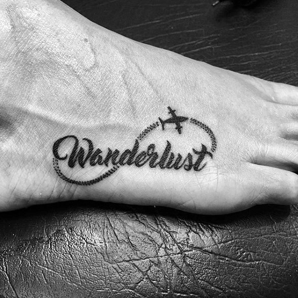 Guys Wanderlust Flying Plane Foot Tattoo