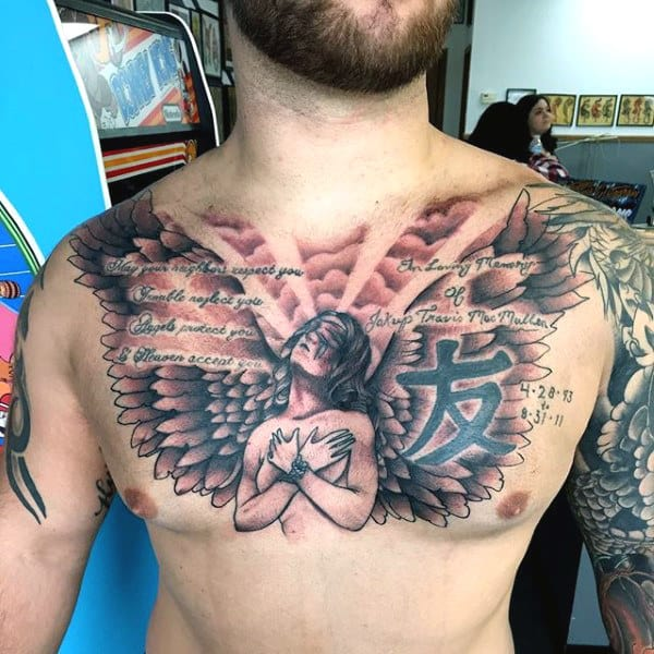 Guys Wing Tattoo On Chest Of Angel