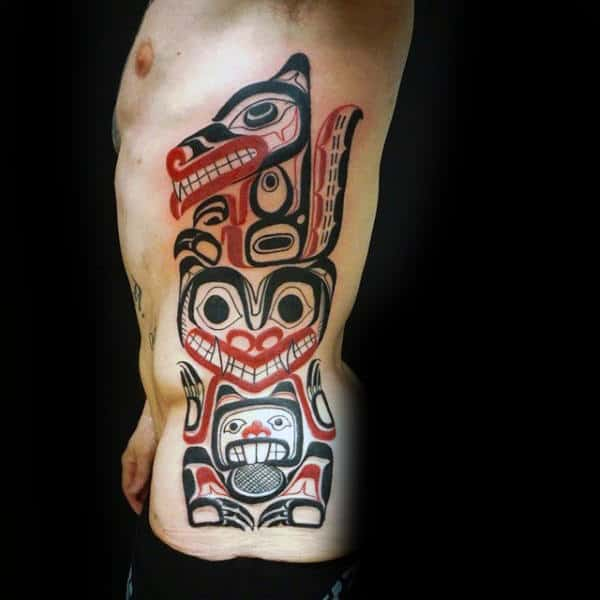 Haida Totem Pole Mens Red And Black Ink Rib Cage Side Tattoos