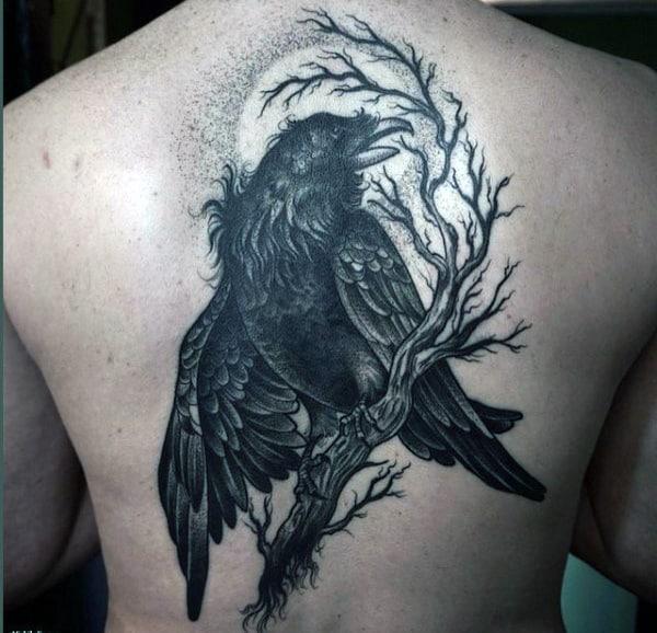 Hairy Dark Raven On A Twig Tattoo Male Back
