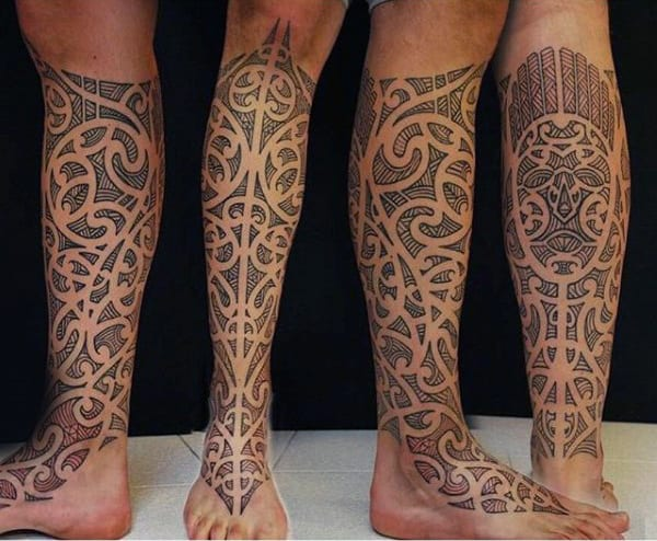 Half Leg Sleeve Maori Inspired Male Tattoos