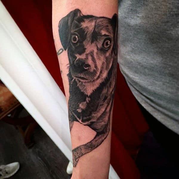 Half Sleeve Arm Tattoo On Man Of Dog