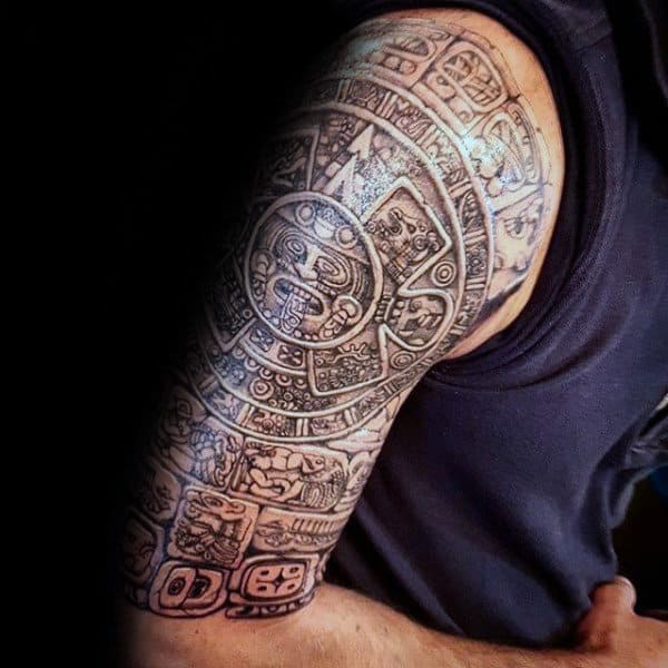 Half Sleeve Male Mayan Stone Tattoo Deisgn Inspiration
