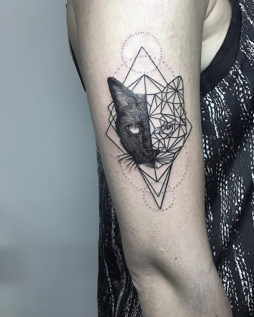 Halved Cat Realist And Line Shapes Framed By Triangles Awesome Upper Arm Geometric Tattoo
