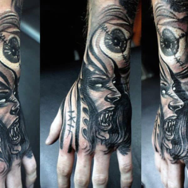 Hand And Wrist Vampire Tattoo Design On Man