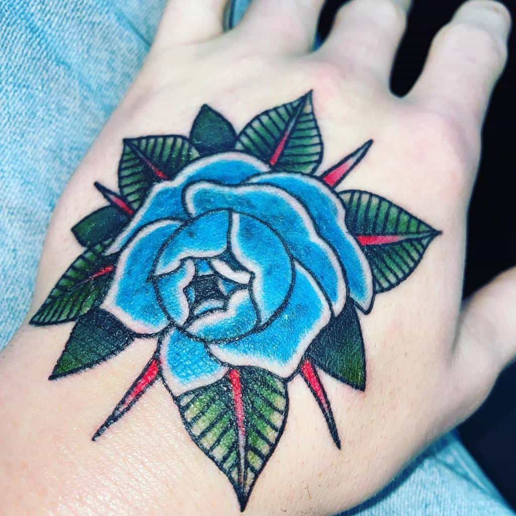 hand blue rose tattoos haldermanzion