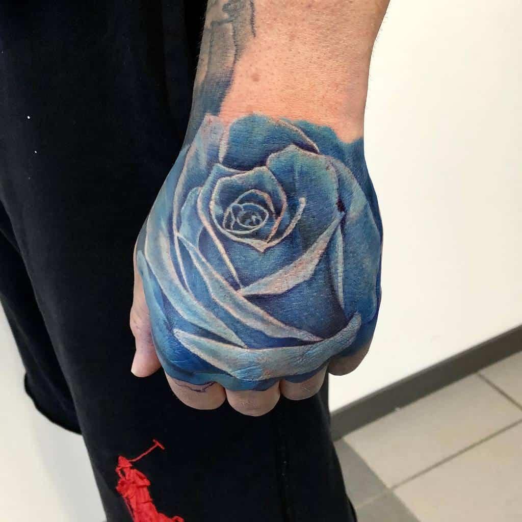 hand blue rose tattoos karolczajkowski