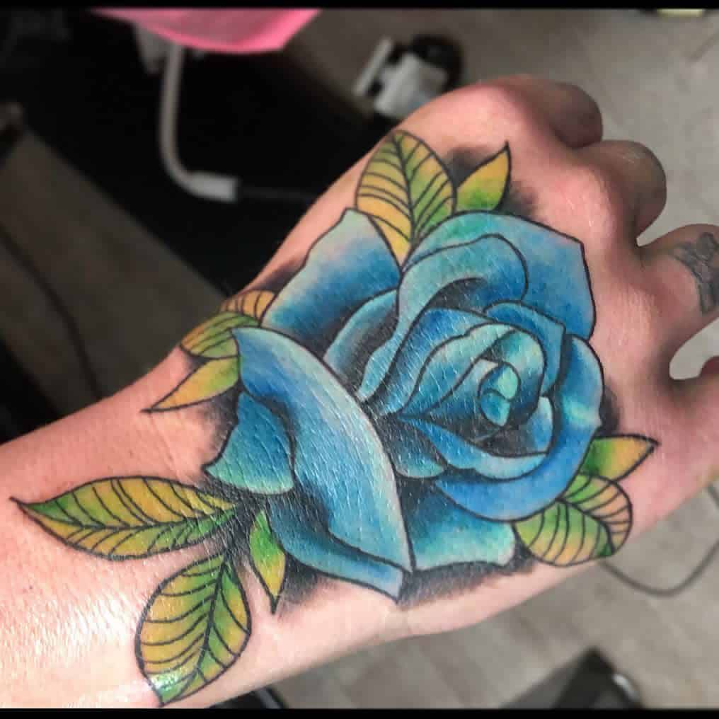 hand blue rose tattoos photobomtom86