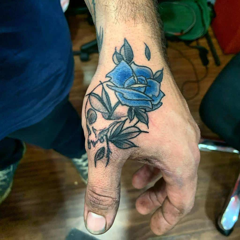 hand blue rose tattoos the_well_is_deep