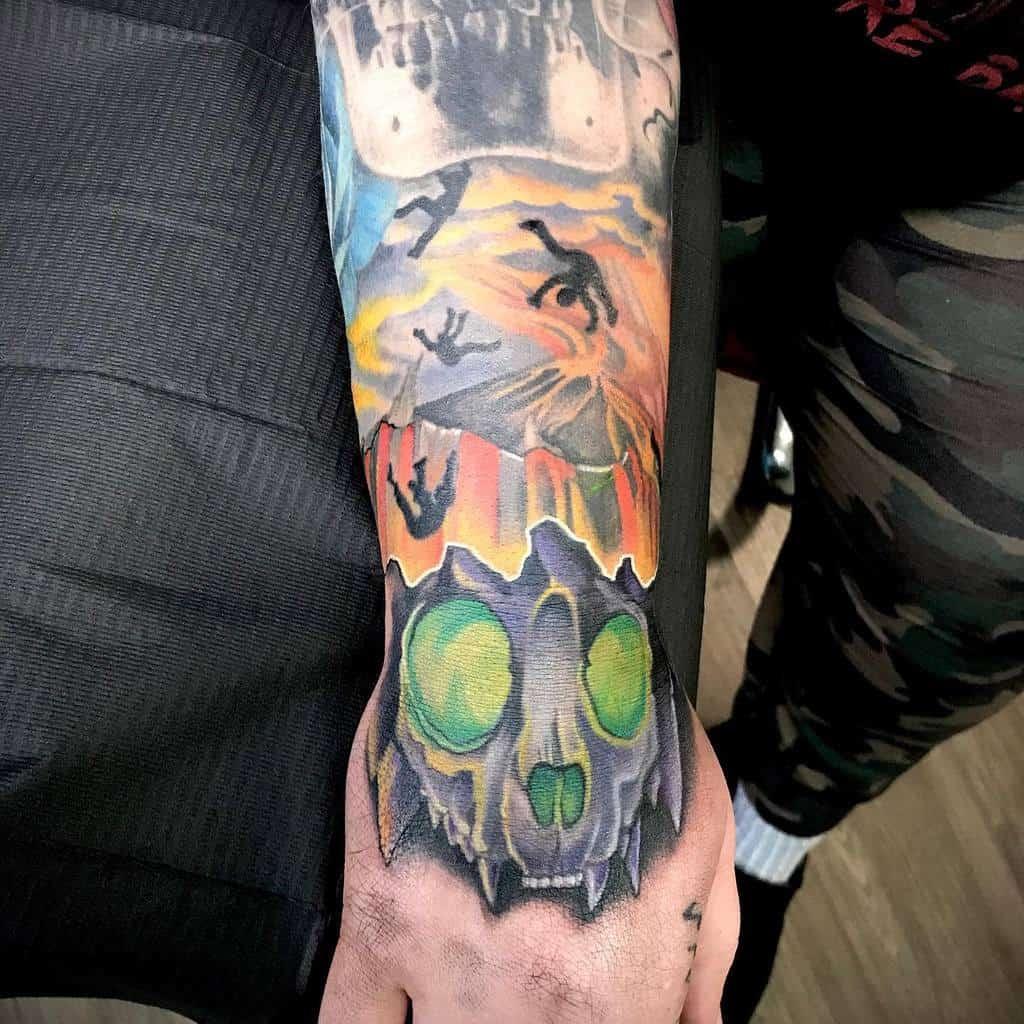 hand cat skull tattoo bitztattoo