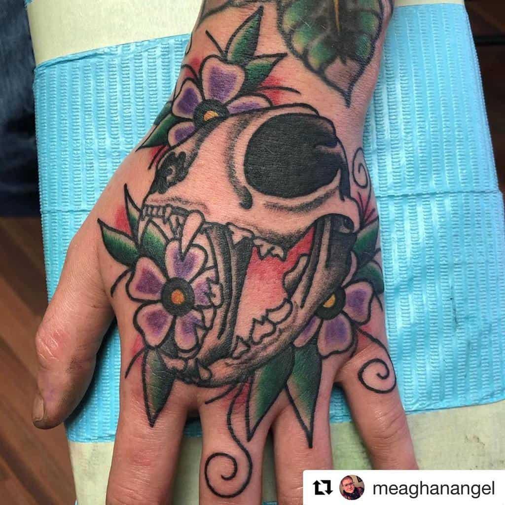 hand cat skull tattoo capefeartattoowilmington