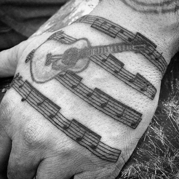 Hand Guitar With Music Staff Tattoo Ideas On Guys