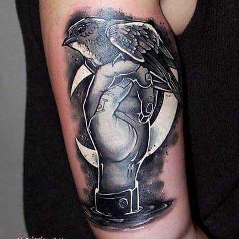 Hand Holding Bird Upper Arm White Ink Tattoos For Guys